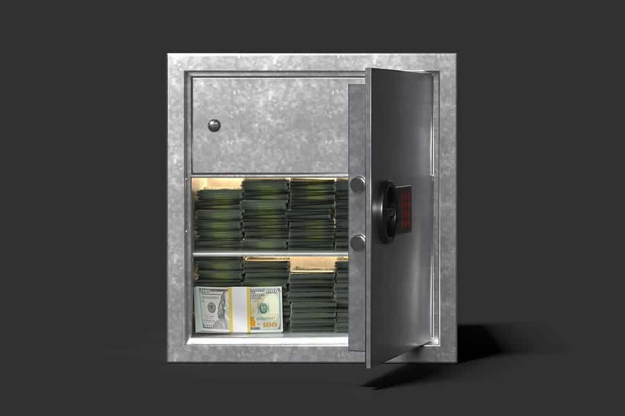 Safe with money isolated on black background. 3d rendering.
