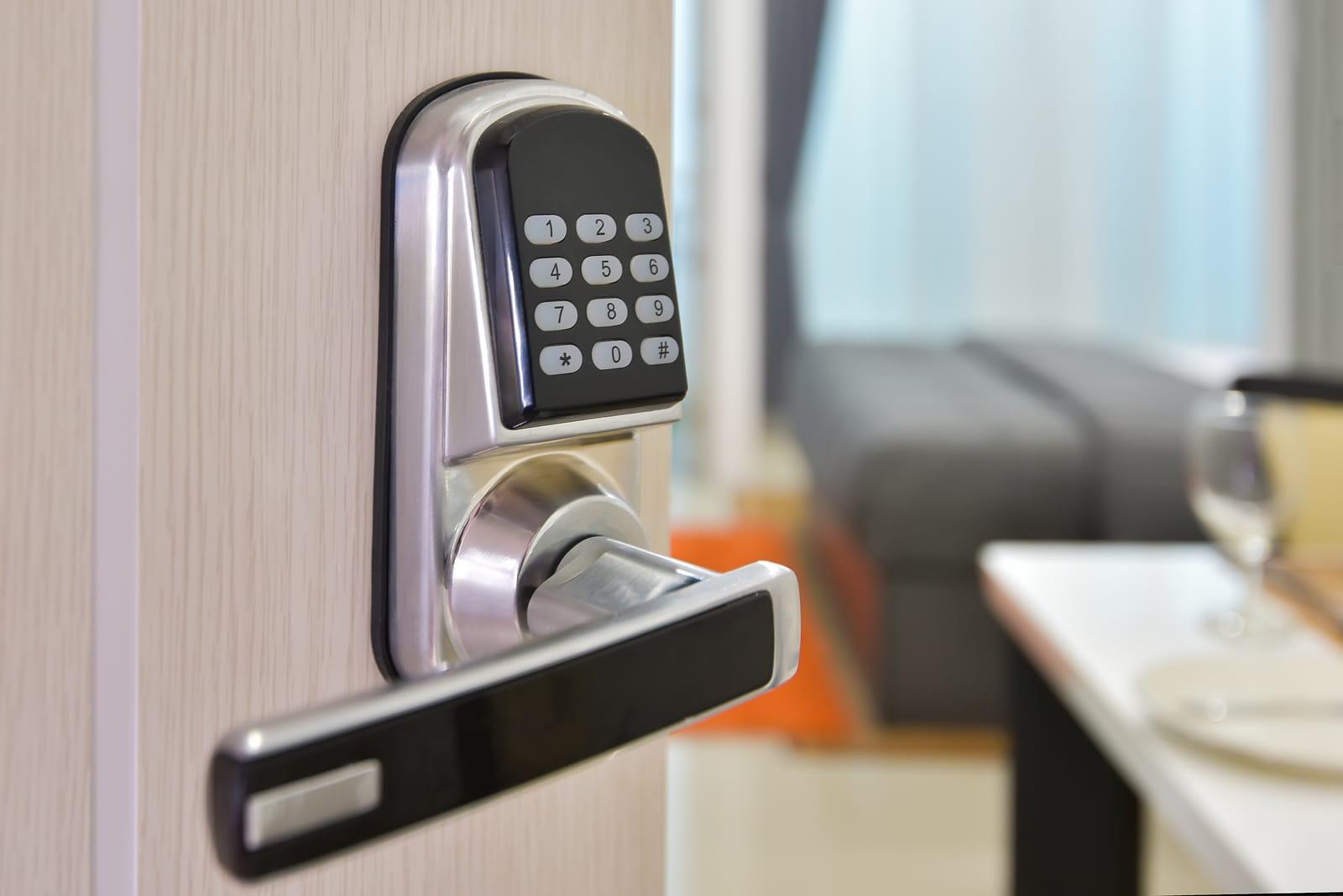 Electronic door access control system machine with number password door..Half opened door handle closeup entrance to a living room.Door lock with keys number.