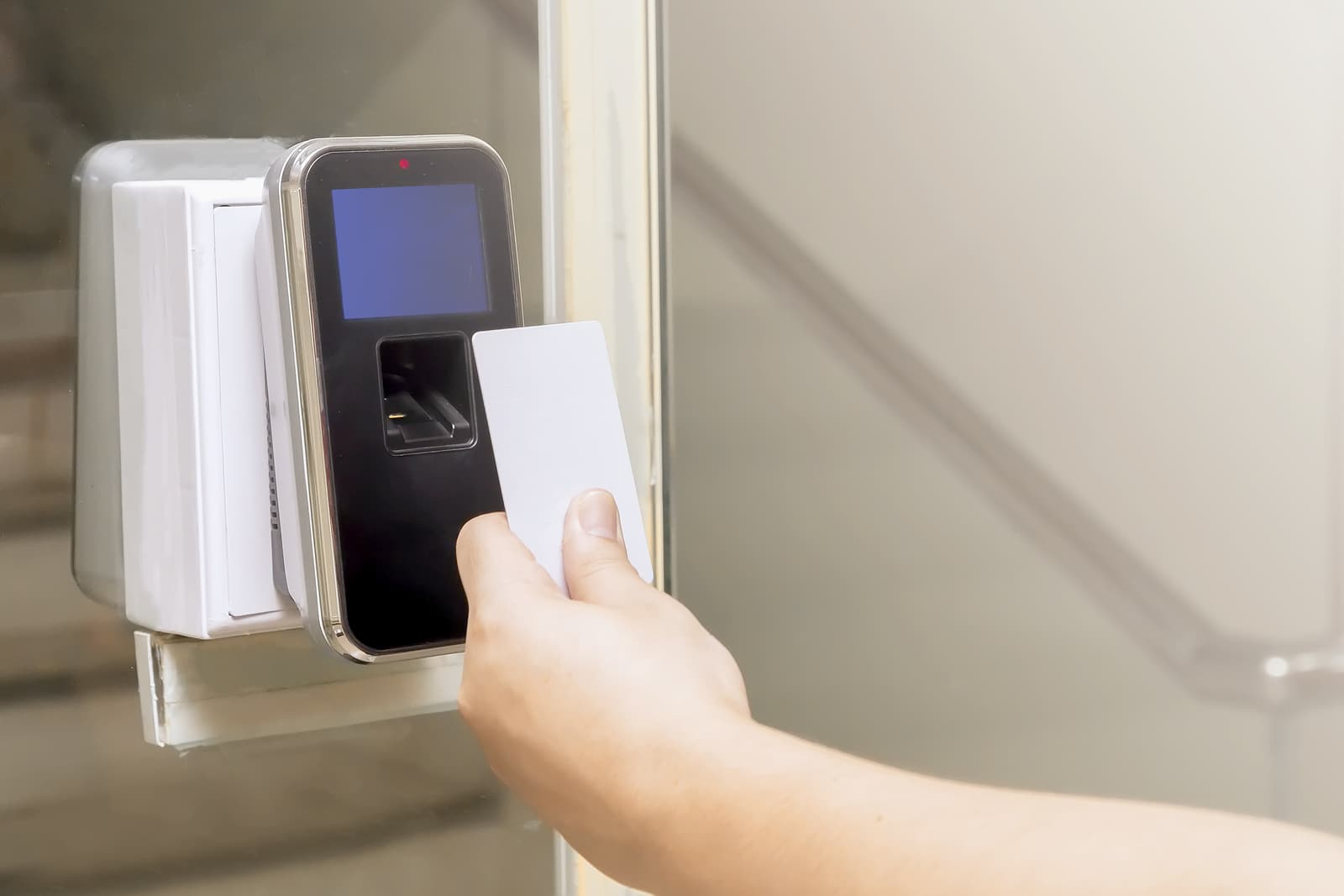 Close up of the hand with key card are scanning for enter digital security door system in the office building
