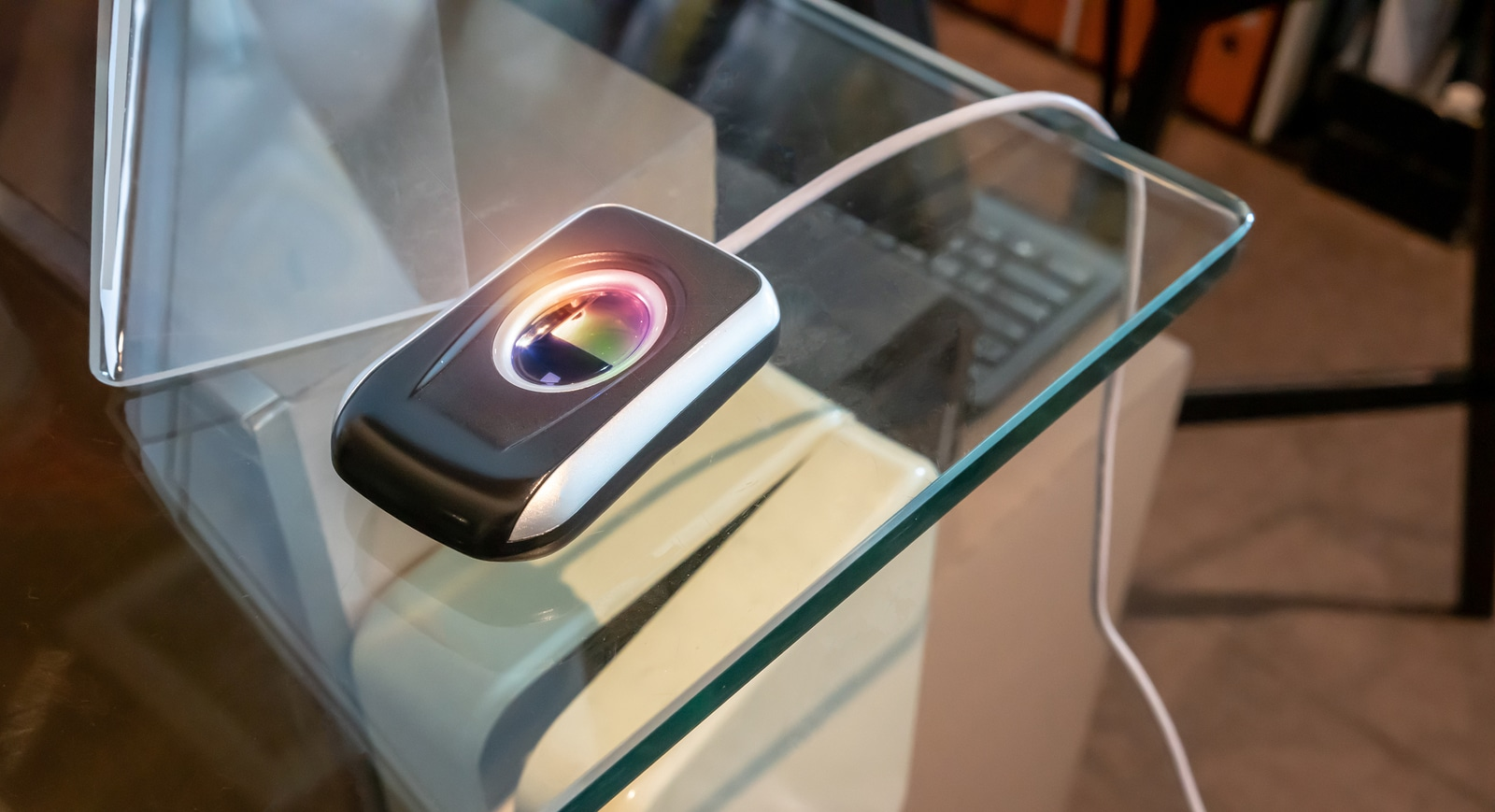 Fingerprint scanner on glass table for check-in security system. Fingerprint and password lock in a office building, The fingerprint scanner control machine for record work time, unlock door office.